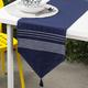 Linges de table Ricardo bleu marine à broderies et à pompons