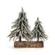 2 arbres de Noël brillants sur bûche