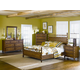 Magnussen Furniture Palm Bay 4-Piece Poster Bedroom Set in Toffee