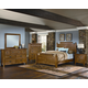 All-American Timber Mill 4-Piece Broomhandle Poster Bedroom Set in Oak