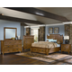 All-American Woodlands 4-Piece Broomhandle with Storage Poster Bedroom Set in Oak