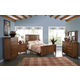 New Classic Logan 4-pc Panel Bedroom Set in Spice