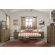 Cinrey 4-Piece Panel Bedroom Set in Medium Brown