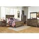 Trinell 4-Piece Panel Bedroom Set in Warm Rustic Oak
