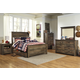 Trinell 4-Piece Panel with Underbed Storage Bedroom Set in Warm Rustic Oak