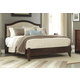Corraya Queen Upholstered Queen Panel Bed in Medium Brown