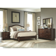 Corraya 4-Piece Upholstered Panel Bedroom Set in Medium Brown
