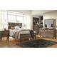 Debeaux 4-Piece Panel Bedroom Set in Medium Brown