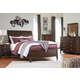 Evanburg 4pc Sleigh Bedroom Set in Brown