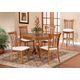 Hillsdale Bayberry 5pc Round Single Pedestal Dining Room Set in Oak