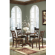 Leahlyn Round Dining Table Set in Medium Brown