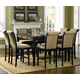 Coaster Cabrillo 7-Piece Counter Height Dining Room Set in Black/Amaretto