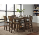 John Thomas Furniture Canyon 7-Piece Extension Pub Dining Room Set in Graphite