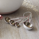 Sur La Table® White & Red Enamel Measuring Spoons, Set of 4