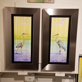Great blue herons.
