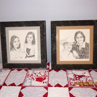 Closeup of original ink art with mat, glass and frames.