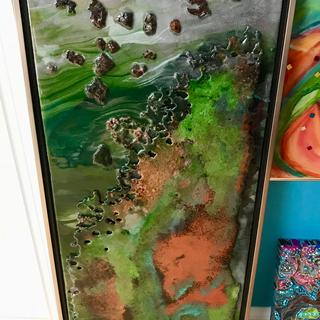 Rusted painted with 3 layers of resin  floating frame was used