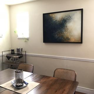 Framed painting in dining room