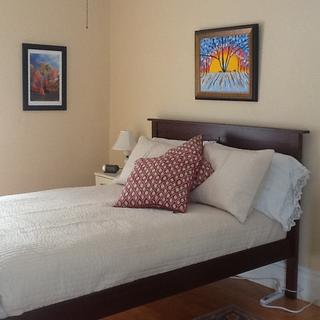 Original, above-the-bed art by a family member is now the centerpiece of the room.