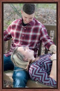 I uploaded this photo of me and my wife and printed it on canvas in a walnut canvas floater frame.