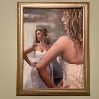 Oil painting  of bride trying on wedding gown. The champagne frame was just right!
