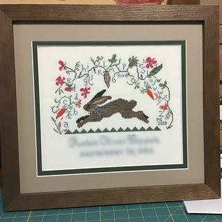 March Hare stitched as a birth sampler.