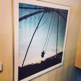 Slim profile, perfect for a stairwell.  High quality metal frame, looks great on the wall!