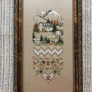 The copper accents in the frame complement the colors of this counted cross stitch piece perfectly.