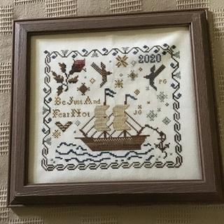 Home from the Sea with Rustic Sandstone frame
