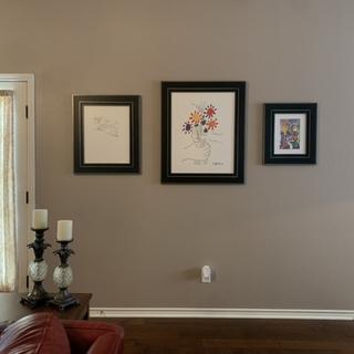 Antiqued  Black and Silver frames with matte acrylic in the living room