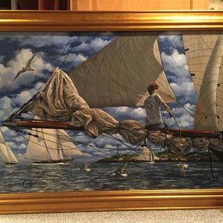 Gold frames are always the right choice for maritime art. The gold makes the blue in the sky pop!