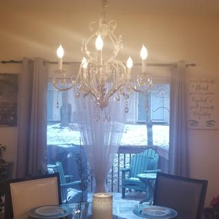 I added a chain cover and it looks amazing!   Fantastic quality chandelier!