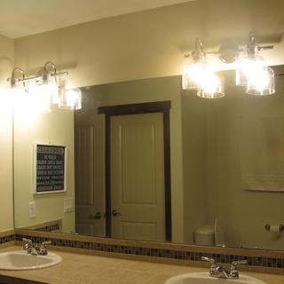 Master Bathroom Vanity Installed 2 sets of Hinkley Chrome Wall Sconces.