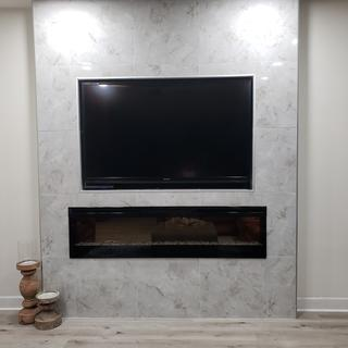 Modern forms magic sconces flanks fireplace.