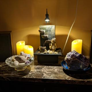 I love my feminine kneeling Buddha. The perfect, subdued water trickle-5 Stars! Thank you Lamps Plus