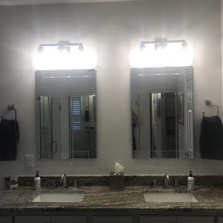 I love my vanity lights.  I used 60 watt bulbs which might be a little bright, but I love it!