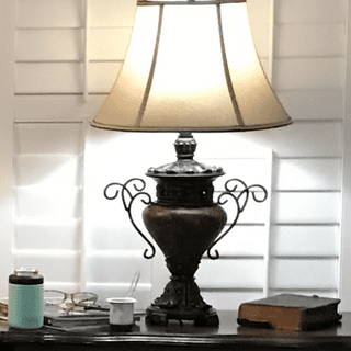 Large bronze urn lamps go well with dark furniture.