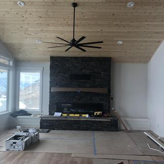 6 foot fireplace with Minka Aire fan. Our custom built home in the finishing stages. Love the fan??