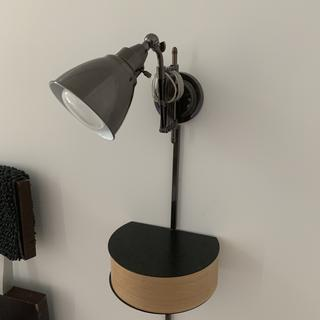 I installed the lamp above a floating shelf to act as a night stand and reading light.