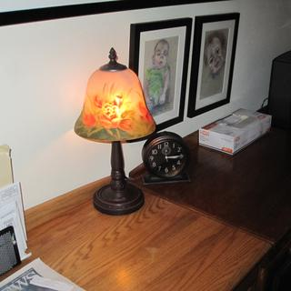 With a small night light bulb, it's the perfect night light for the hallway.  Many compliments.