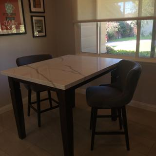 Fits well with 4 chairs to a 40 x50 counter height table