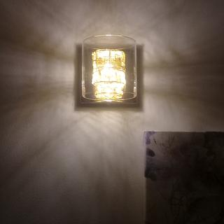 This picture shows how the lamp is on and how it shines around it.