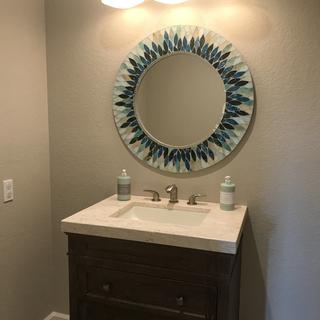 The arc-shape fits nicely over our round vanity mirror.