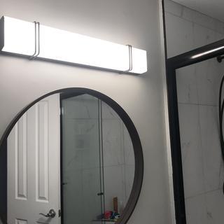 New restroom shower, floating sink, vinyl floor, lamp, mirror, exhaust fan, and toilet. Beautiful!