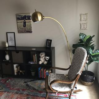 This beautiful floor lamp adds the perfect touch to this grandma's reading nook.