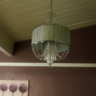 I love this chandelier!   I replaced an old  ceiling fan with this, and I can't stop looking at it!