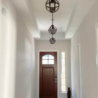 """Entry hallway replacing LEDs with 10"""" Orb pendants."""