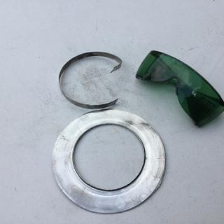 Use safety glasses and make sure you remove the back metal band, which is bigger.