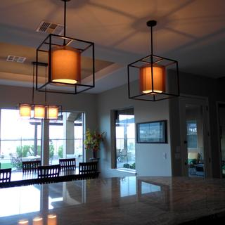 Lights over island and matching chandelier over dining table.