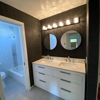 One very gorgeous black crocodile wallpaper vanity room. Lights are perfect.